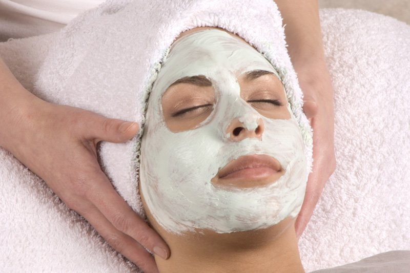 Holistic Facial with green cream on girls face
